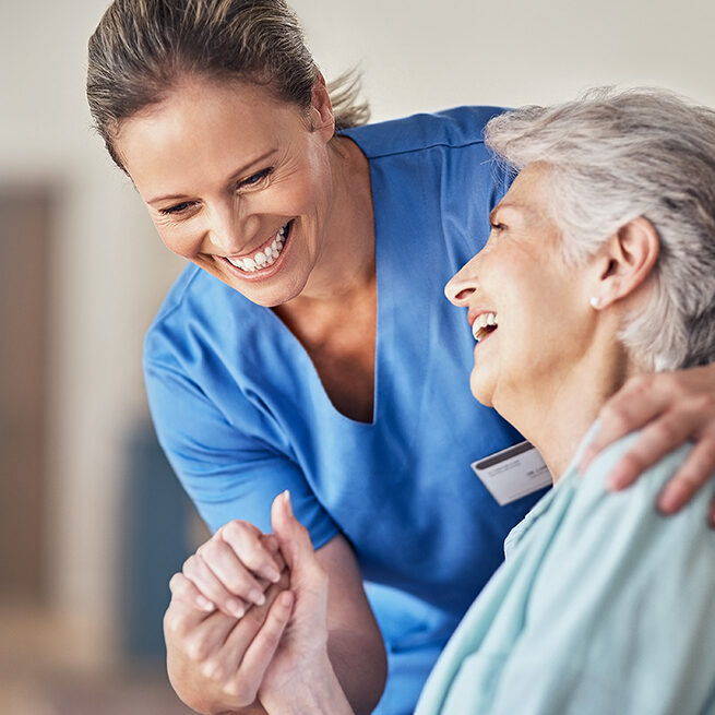 Clinical Care Assistant Helping Elderly Lady at Cambridge Senior Living