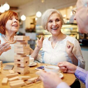 Elderly Friends Enjoying Activities Together in Senior Living Environment